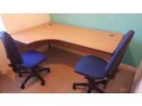 Office desk and filing cabinet.