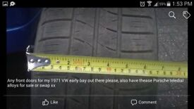 4 Genuine Porsche alloys and firestone tyres