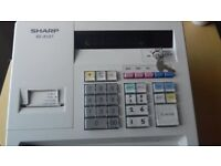 Sharp XE-A107 Cash Register White - used but still works well.40 till rolls and 5 ink rollers inc