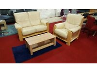 2 piece cream leather suite with oakwood frame