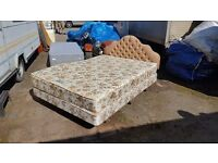 Double bed on legs with mattress and headboard. Good condition.