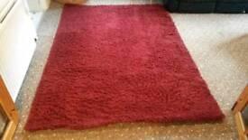Large red shag pile rug