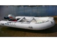 3.8 meter swift inflatable rib boat with outboard engine and trailer.