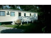 LOOE BAY CORNWALL. PRIVATELY OWNED 8 BERTH STATIC CARAVAN FOR HIRE
