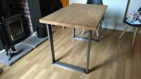 solid oak dinning table with steel legs