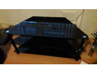 Black glass tv unit ,hold upto 32 i think
