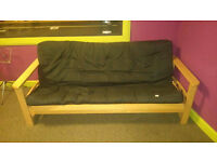 Wooden sofa bed futon for sale, in good condition.