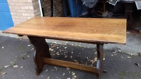 solid oak dining table, long 135cm,wide 70cm,made in England,no chairs