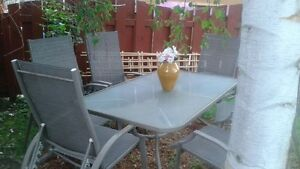 Beautiful outdoor table set with 6 chairs