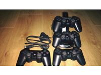 PS3 controllers and charging stand