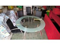 Glass dinning room table and 4 chairs £45