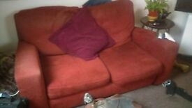 x2 red cord two seater sofas