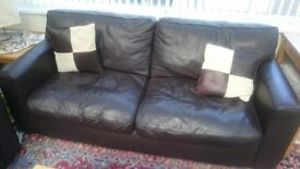 2 x brown leather sofas in good condition with matching leather footstool