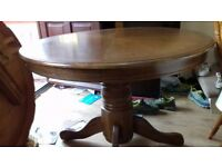 Round dining table,solid oak,non-extendable,carved,105cm,adjust screws,no chairs