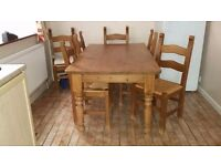 Solid pine Dinning table with 6 chair in good condition for bargain price of £250