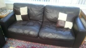 2 x brown leather sofas in good condition with matching leather/storage footstool