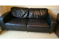 Black sofa with wooden legs