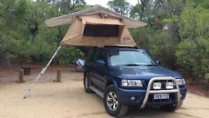 Holden Frontera SE 2002 4WD with rooftop tent and camp gear