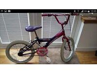 "Girl's 18"" wheel bike."