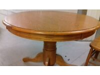 Round dining table,solid oak,non-extendable,carved,105cm,adjust screw,no chairs