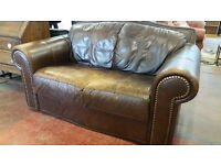 2 seater leather sofa with stud detail