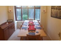 Large 10 seat dining table and 8 chairs