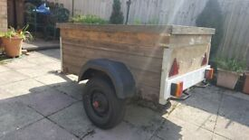 Single axle trailer with spare wheel