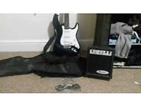 Rockburn guitar with amp & accessories