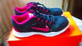 Black Nike trainers, size 6