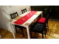 4 x wooden chair and white dining table + cushions in bury