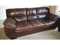 Two large 3 seater dfs Italian leather sofas. Only 2 years old, fire safety labels still attached!