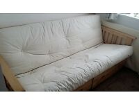 Double Futon/ Sofa bed with Cream cushion mattress, wooden frame with 2 storage drawers underneath.