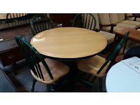 Circular farmhouse style table with 4 chairs