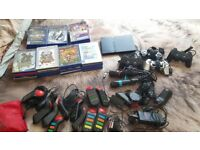 Playstation 2 bundle ,31 games, 4 controllers, mic's, party controllers + More