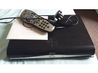 Sky + HD box with wire remote and info guide TV