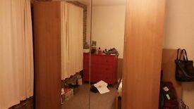 Wooden bedroom wardrobes with mirror doors