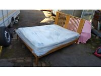 Wooden framed king size bed with Westminster beds Windsor orthopaedic mattress. Unused.