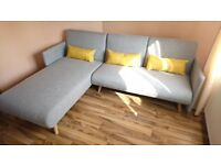 Brand New Corner sofa bed in light gray fabric.