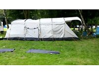 Vango 8 person tunnel tent with sewn in ground sheet, carpet and 4 camp beds