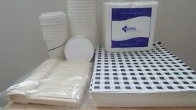A selection of catering supplies, cups with lids, greaseproof paper etc ECO friendly