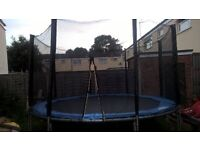 12ft trampoline with encloser .