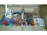 Nintendo Wii console with remotes games and extras