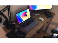 Macbook pro 2016 touchbar version mint condition £1300 no offers.