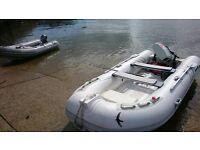 Semi rigid boat rib with 25hp outboard and trailer