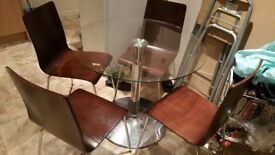 Glass Dining table and chairs Excellent Condition