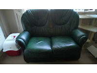 Small Two Seater Green Leather Sofa with matching swivel recliner chair and footstool