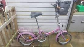 Pink girls fold up bike