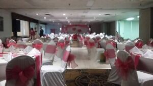 Wedding chair covers, fuschia ribbons and running table