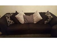 3 seater sofa with swivel chair and pillows