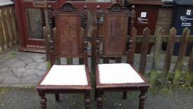 2 luxury dining chairs,carved,rattan,back,solid oak,stable, broken,no table